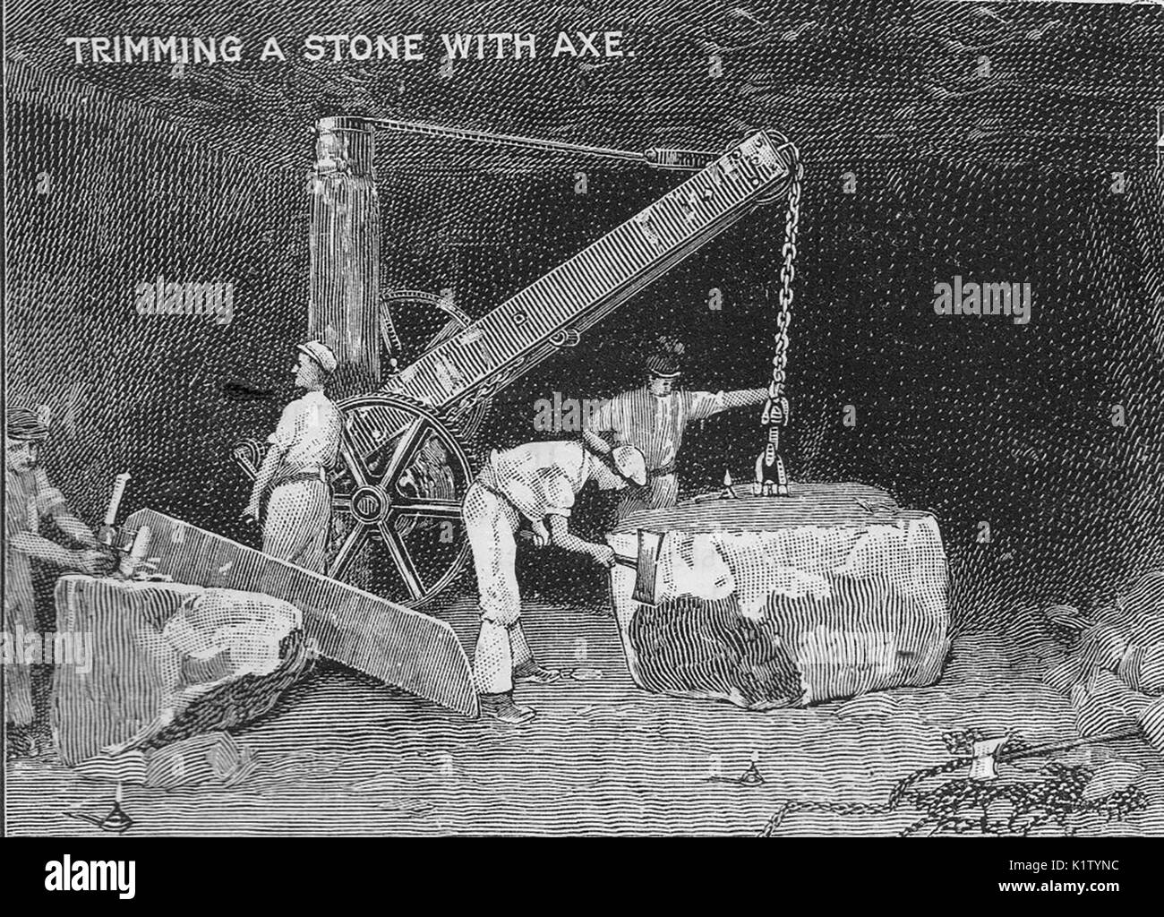 Bath Stone - Trimming a stone block with an axe - Stock Image