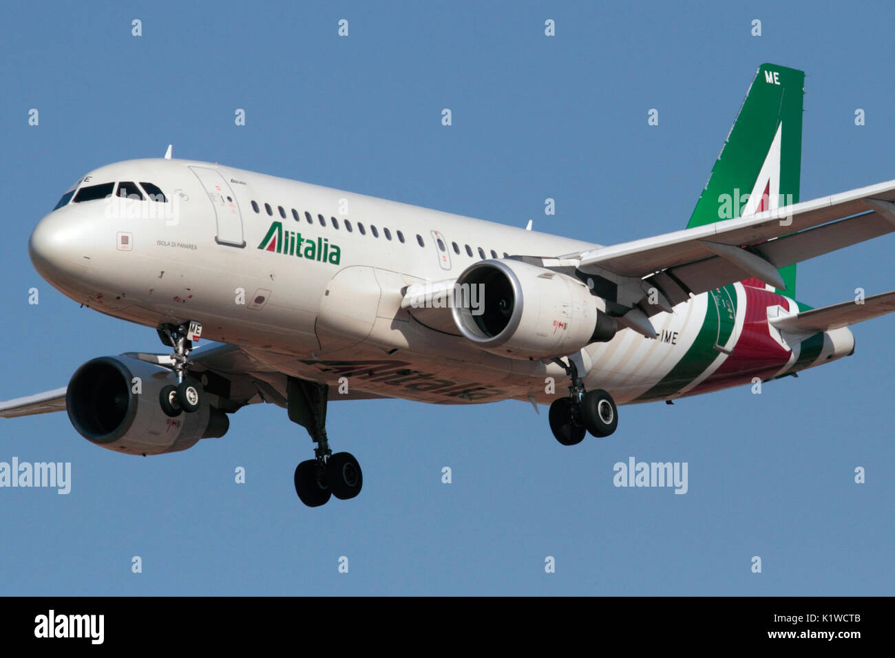 Closeup of an Alitalia Airbus A319 passenger jet plane on approach in the airline's new livery - Stock Image