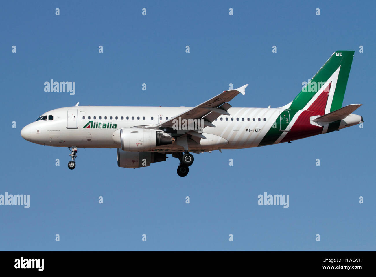 Side view of an Alitalia Airbus A319 airliner in the airline's new livery - Stock Image