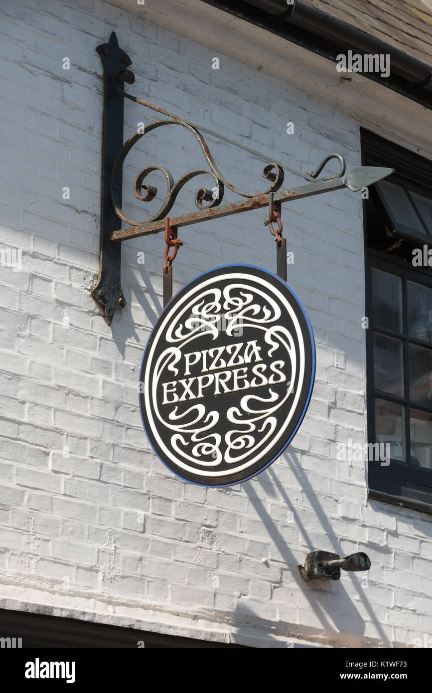 A Pizza Express Sign Hanging On A Wall Outside A Restaurant