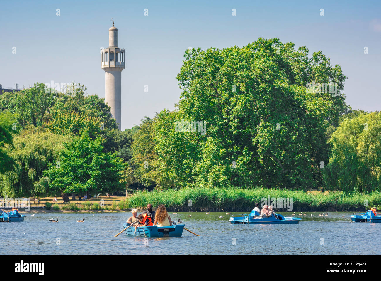 Regent's Park London, tourists in boats enjoy a summer afternoon on the boating lake in Regent's Park, London, UK. Stock Photo