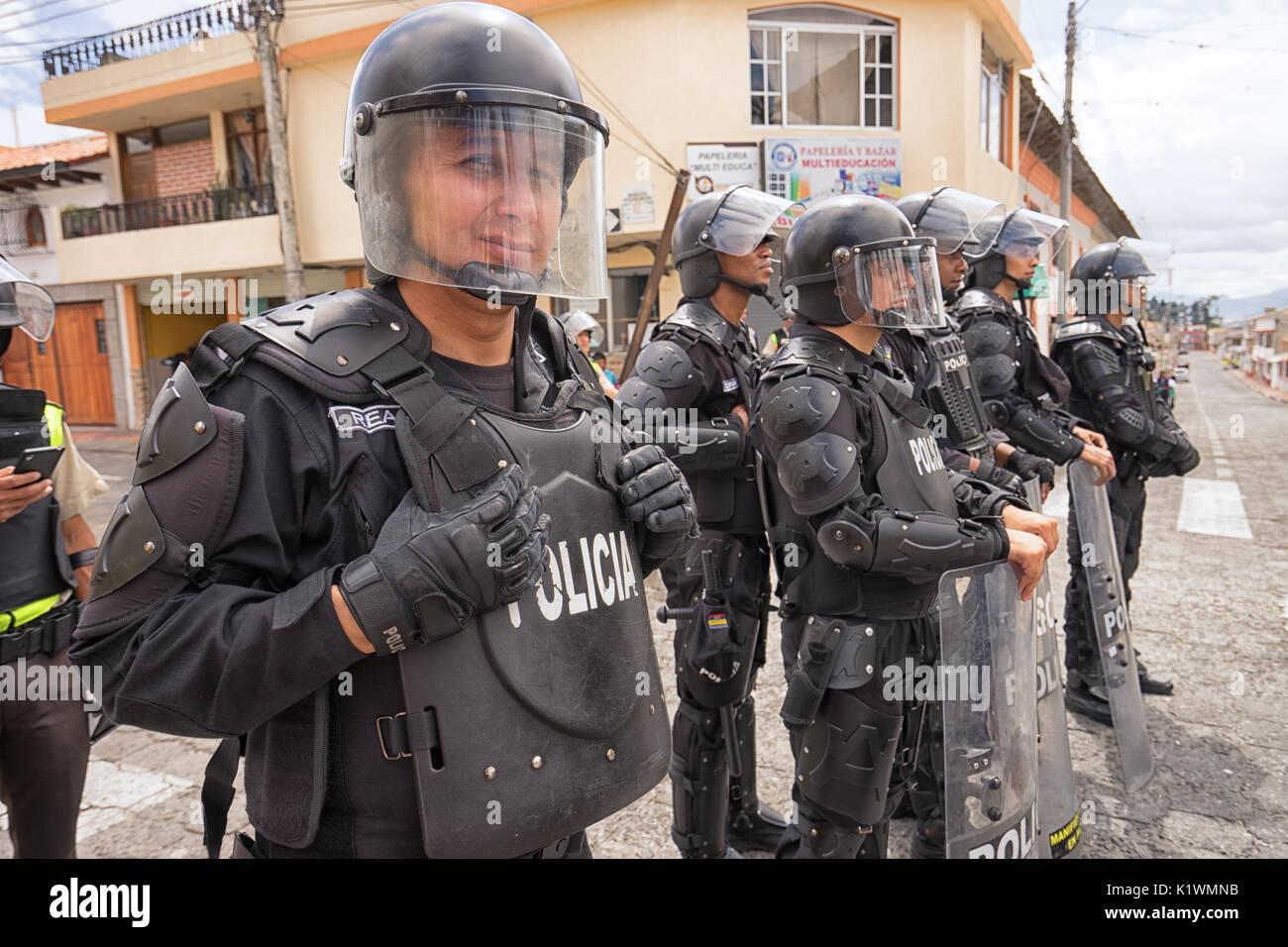 riot police in action in Cotacachi Imbabura Ecuador during inti raymi parade at summer solstice - Stock Image