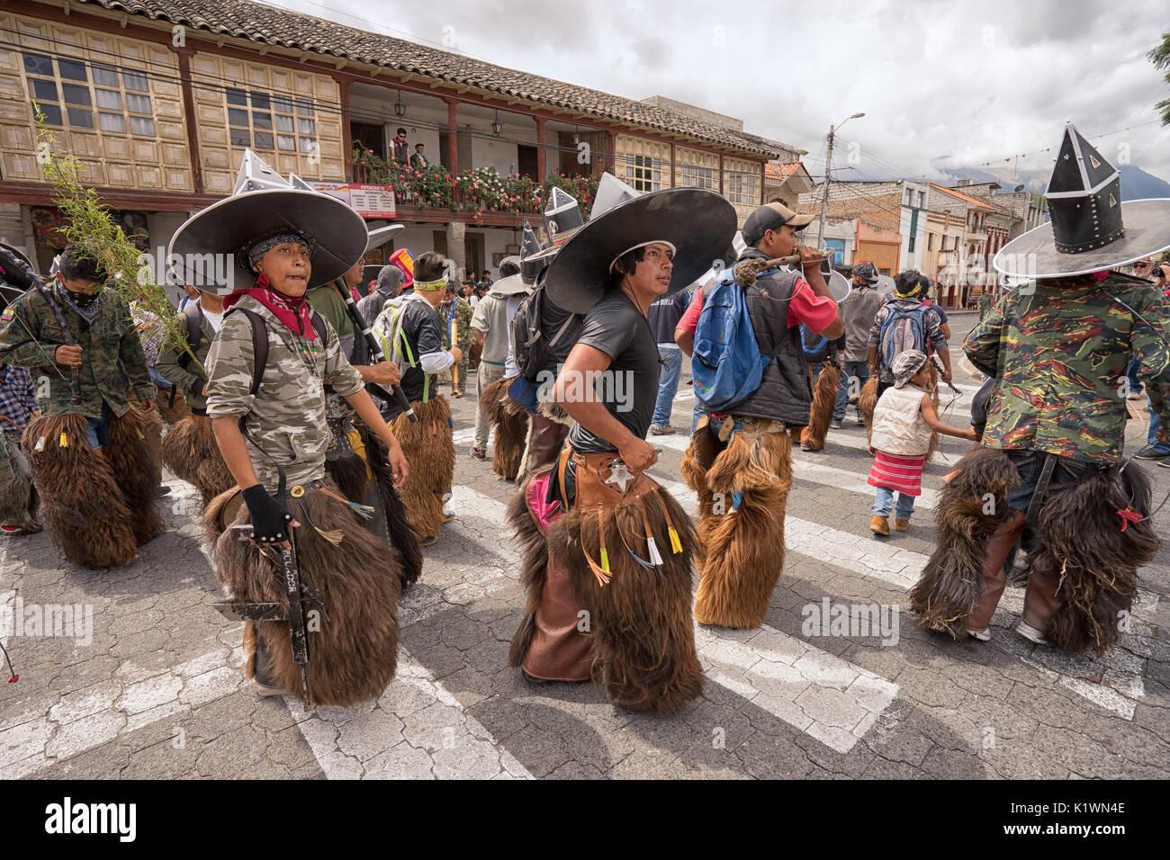 June 24, 2017 Cotacachi, Ecuador: a group of indigenous kichwa men dancing at the Inti Raymi parade at summer solstice - Stock Image