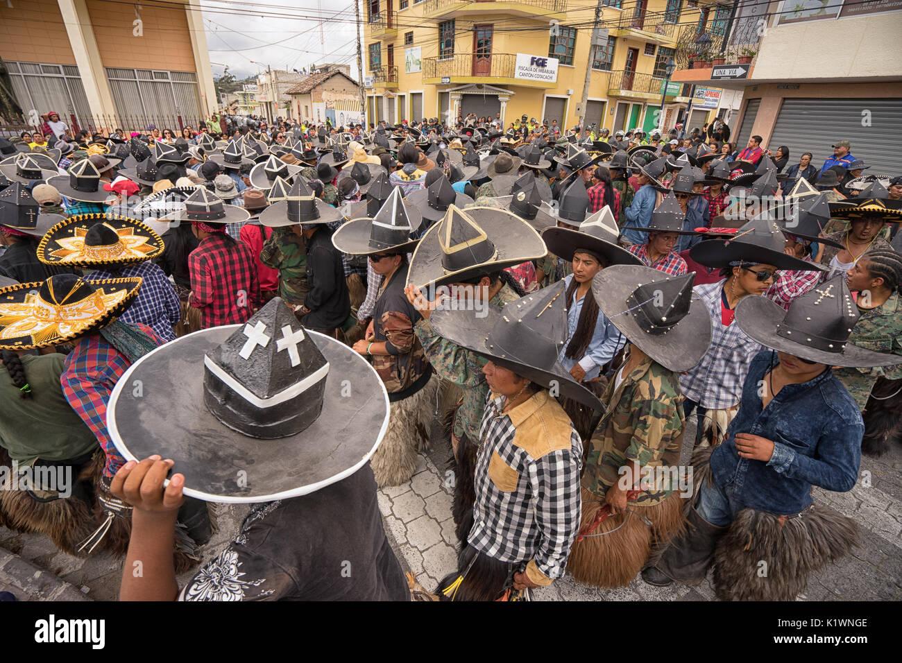 June 24, 2017 Cotacachi, Ecuador: aindigenous kichwa men dancing at the Inti Raymi parade at summer solstice - Stock Image