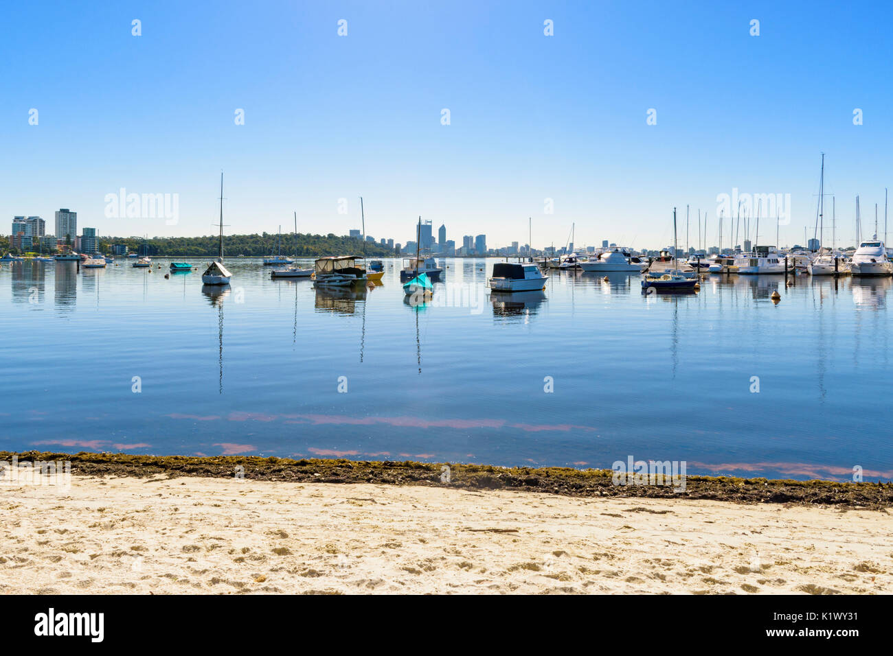 Boats moored at Royal Perth Yacht Club in Matilda Bay on the sandy foreshore of the Swan River, Crawley, Perth, Stock Photo