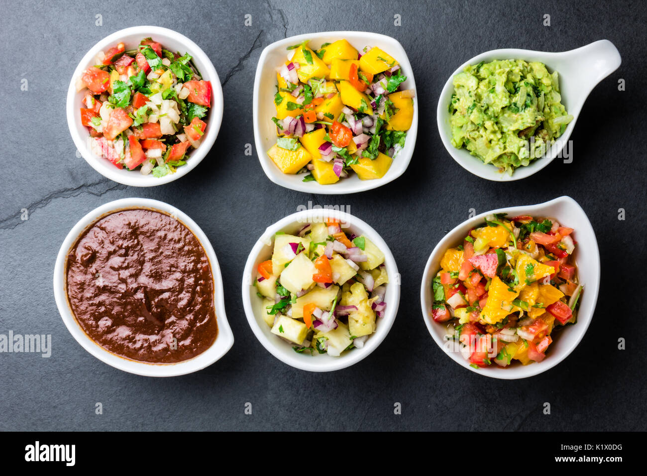 Traditional famous mexican sauces chocolate chili mole poblano, pico de gallo, avocado guacamole, salsa bandera, Stock Photo