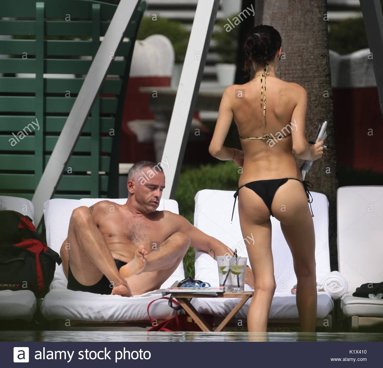 Eros Ramazzotti and Marica Pellegrinelli are seen relaxing, cuddling and  kissing in the pool of their luxury hotel during a holiday in Miami Beach.