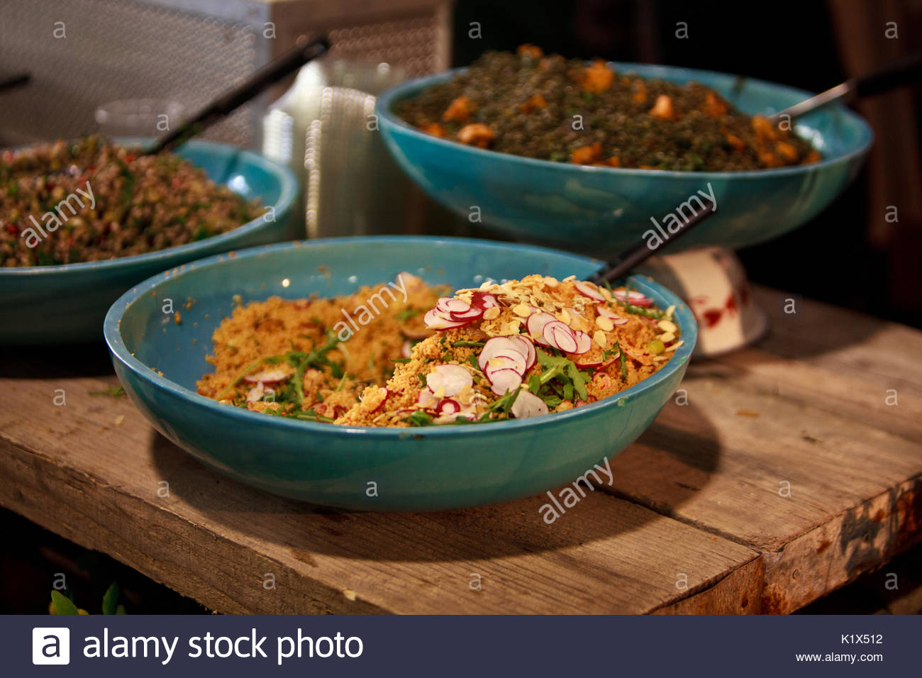 Tasty bowl of salad with blurred background - Stock Image