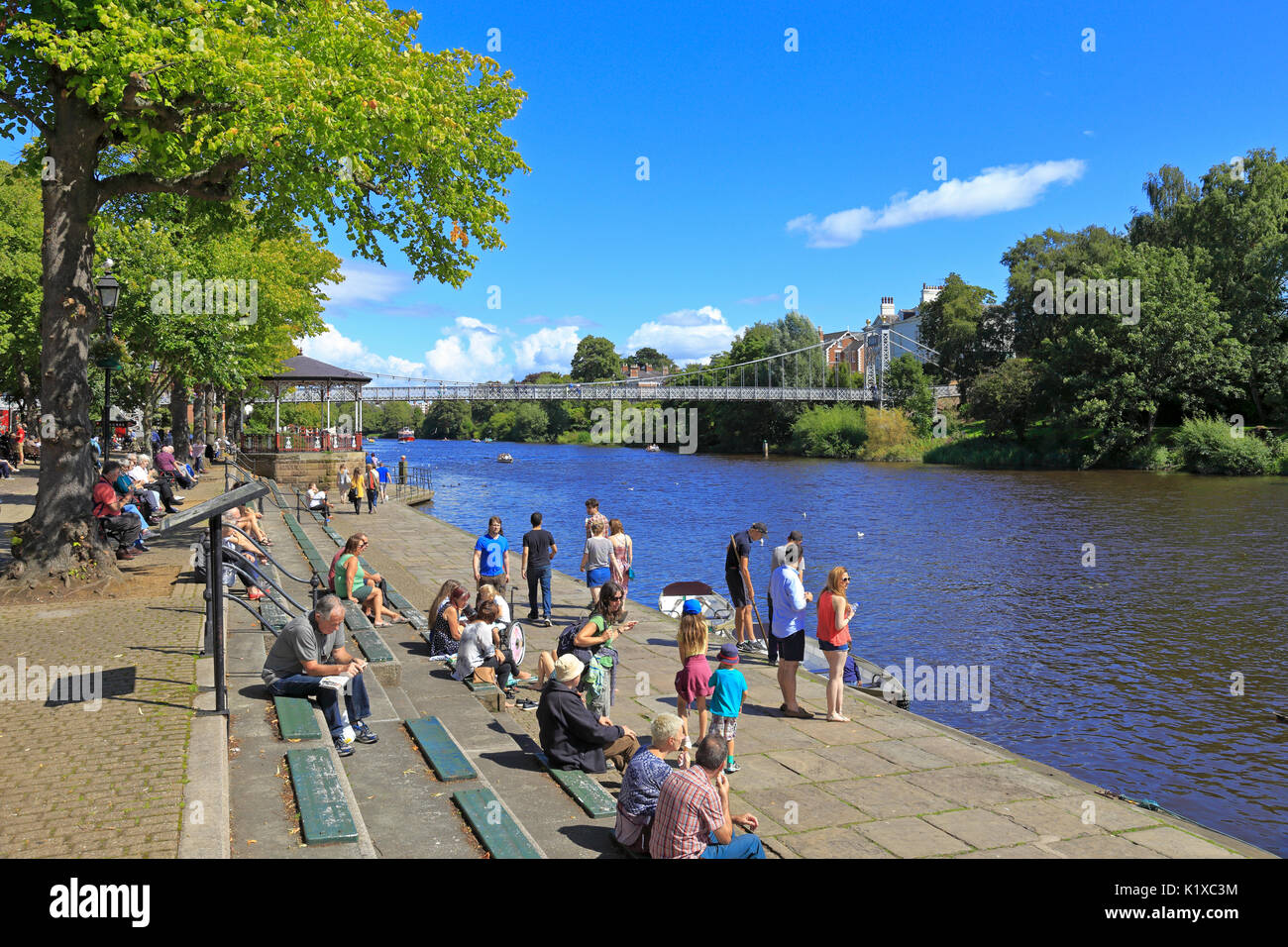 Queen's Park Suspension Bridge over the River Dee, Bandstand and the Groves riverside walk, Chester, Cheshire, England, UK. - Stock Image