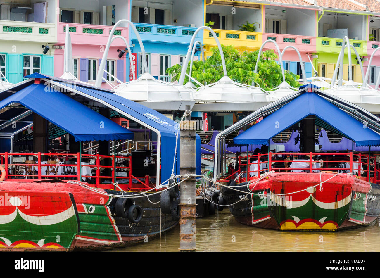 Colourful restaurant boats anchored at Clarke Quay, Singapore - Stock Image