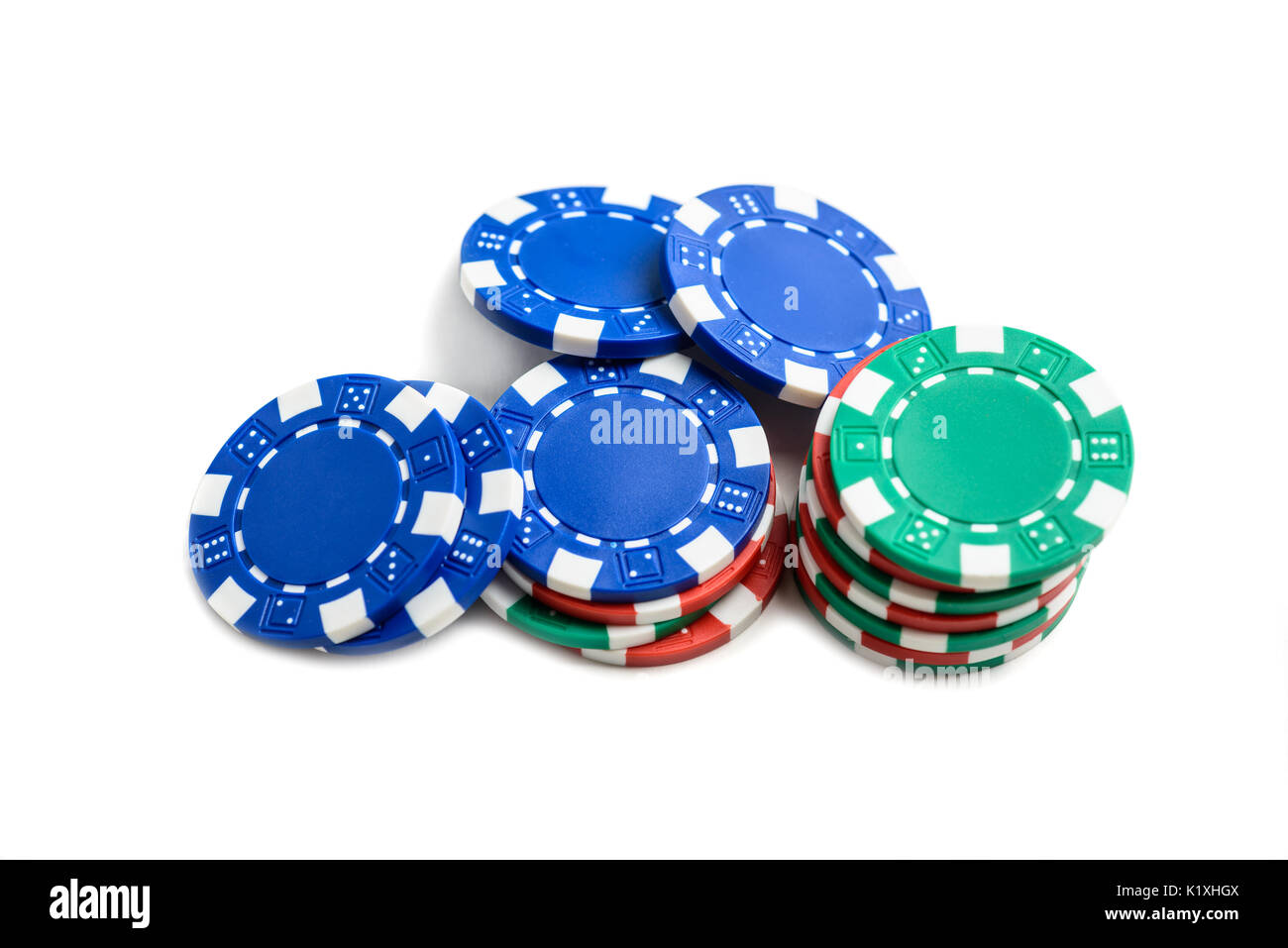 Casino poker chips isolated on white background - Stock Image