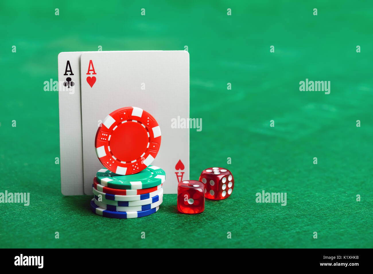 Casino poker chips, dice and cards  on green table background with copy space for your text Stock Photo