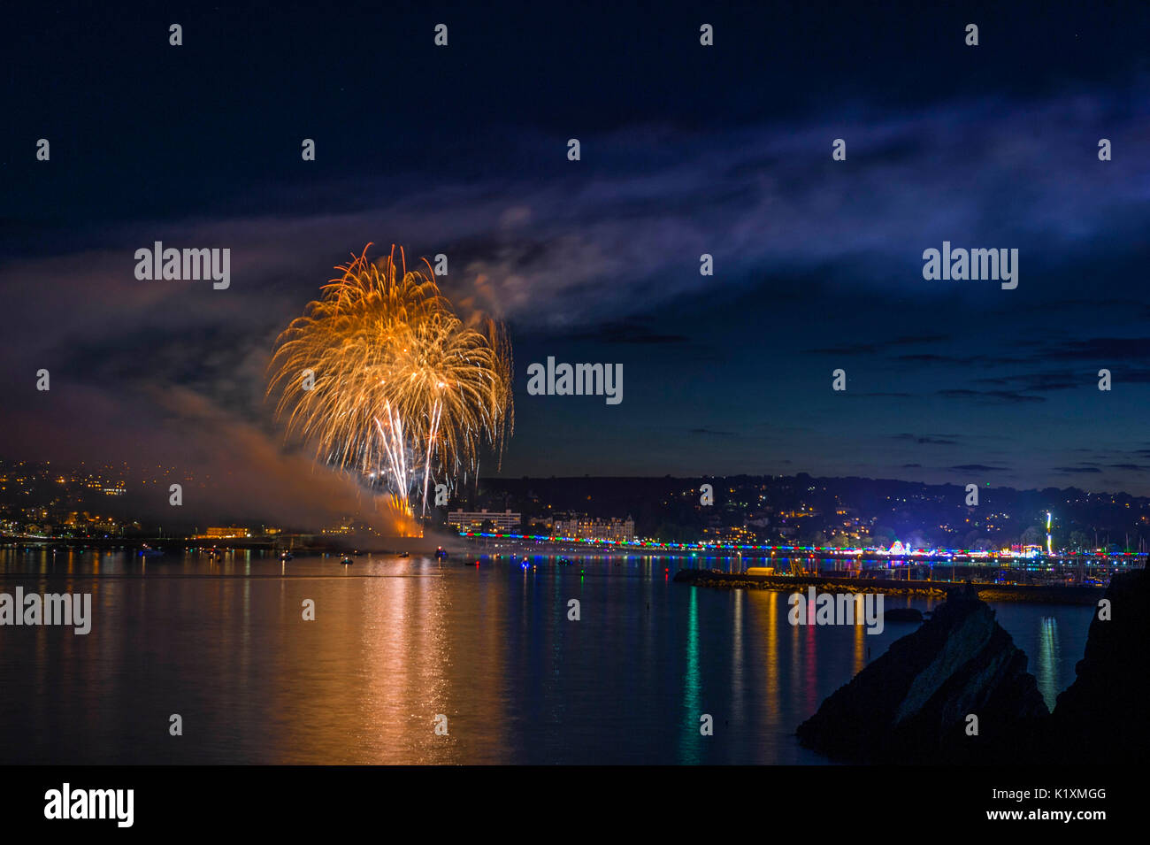 Great British Coastlines, featuring the amazing Torbay Regatta Fireworks display at Corbyn's Head, Torquay on a beautiful summer evening, August 2017 - Stock Image