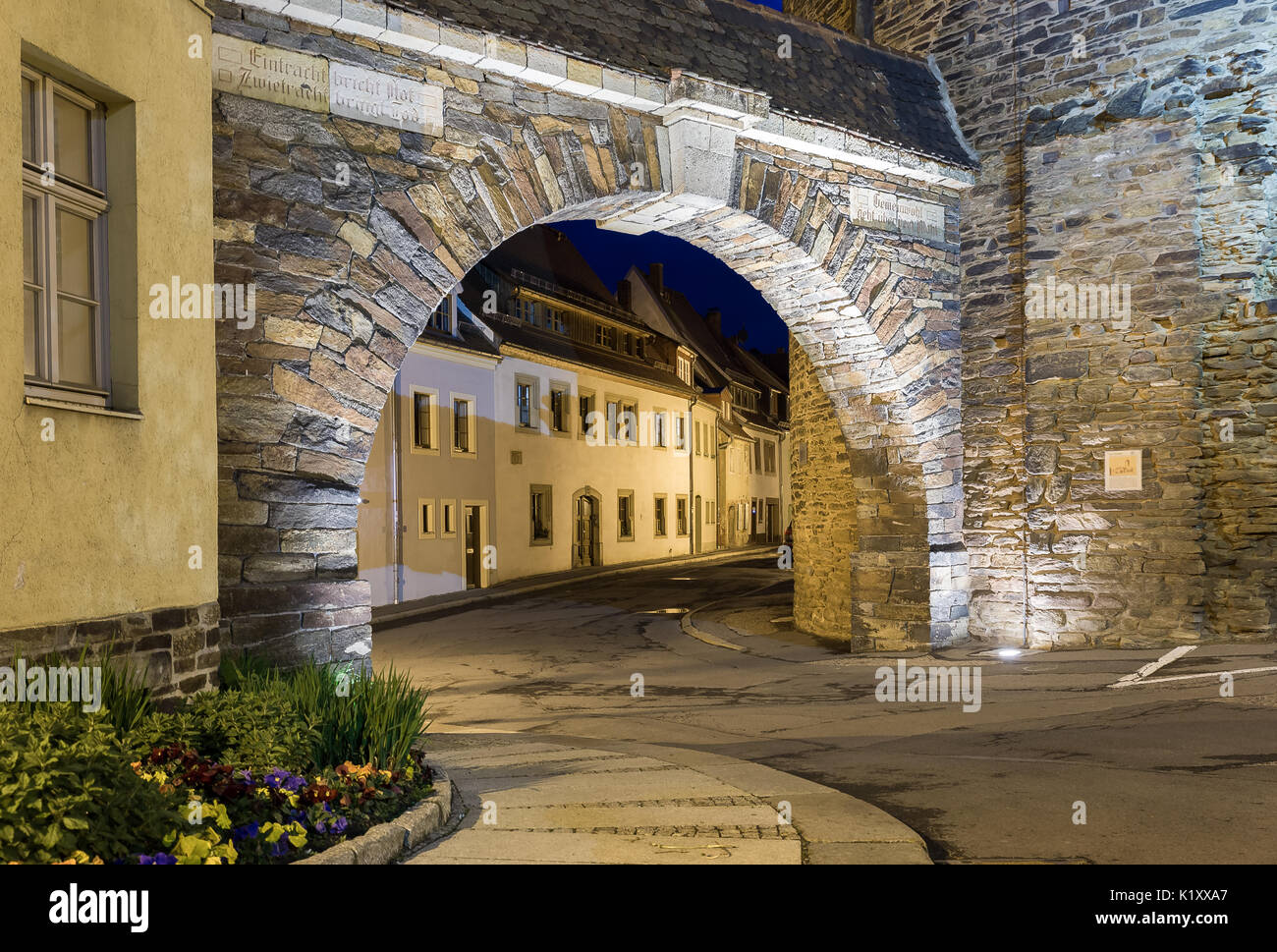 historic city gate in freiberg at night - Stock Image