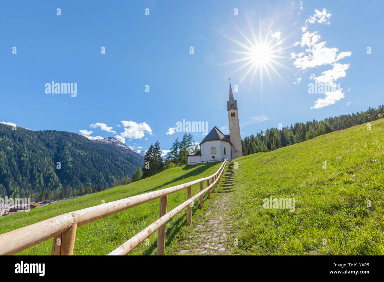 Europe, Italy, Veneto, Falcade. The church of Beata Vergine della Salute (Blessed virgin of health) on the hill over the village of Caviola, Dolomites - Stock Image