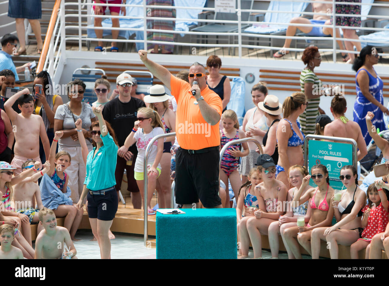 Royal Caribbean's Navigator of the Seas Cruise ship's International Bellyflop Competition hosted by cruise director Cuddy Cudworth and Lizzy - Stock Image