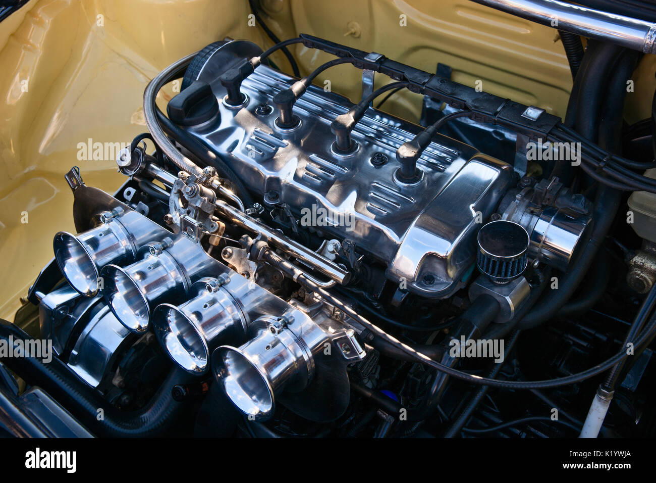 Modern automobile internal-combustion engine. White polished metal and black tubes and wires. Automotive industry Stock Photo