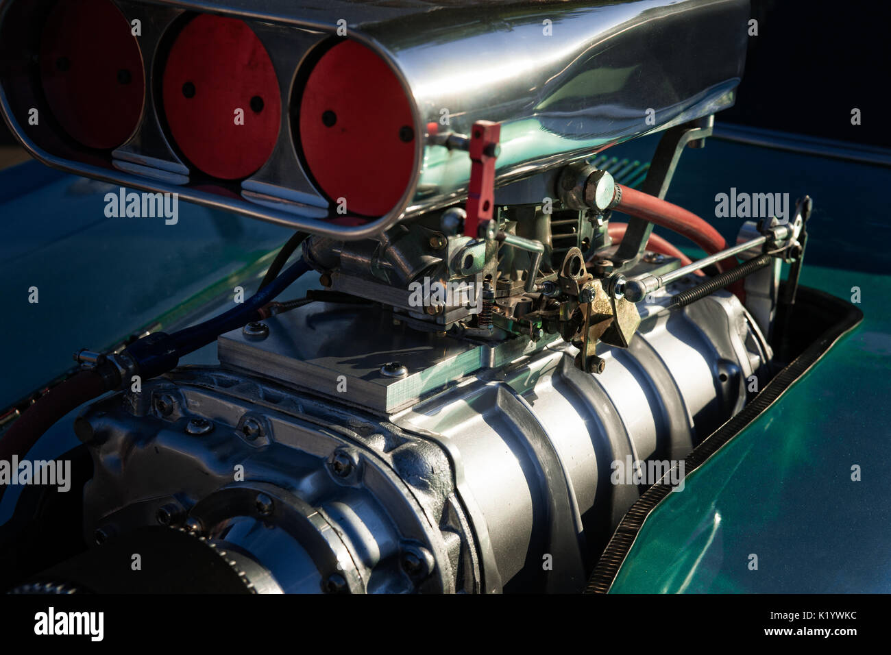 Powerful engine of a hot rod or dragster speed racing car. Metal structure of the engine over the car hood. Engineering automotive technology. - Stock Image