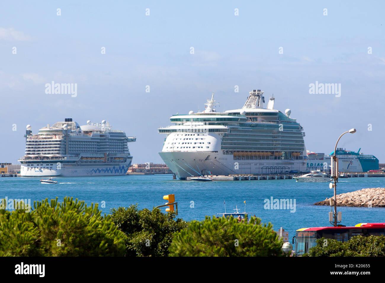Royal Caribbean Navigator of the Seas and AIDA Cruises AIDAperla cruise ships docked at Palma de Mallorca Spain in the western Mediterranean - Stock Image