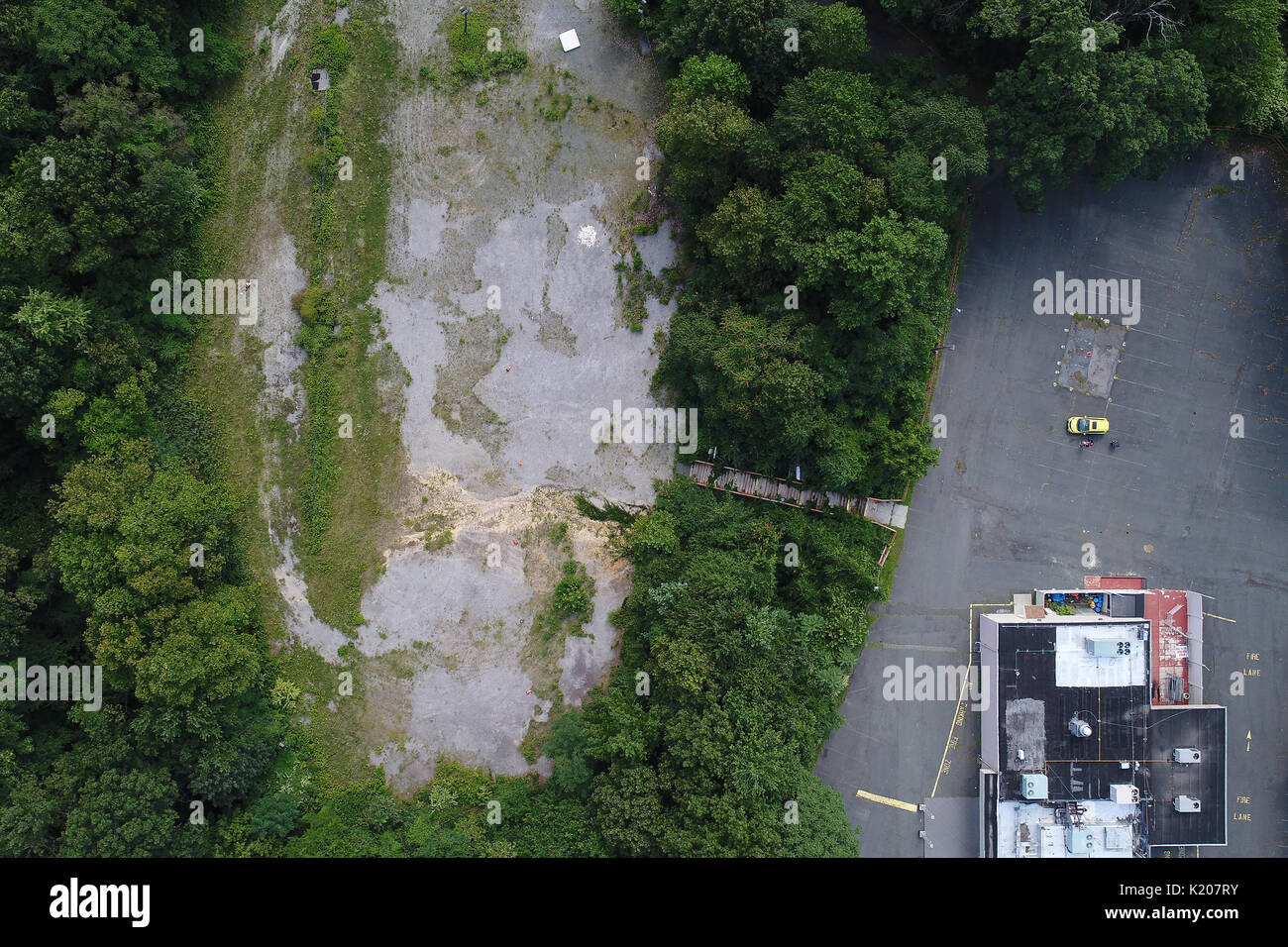Aerial view of Old broken down stairway from unused old parking lot and closed club - Stock Image