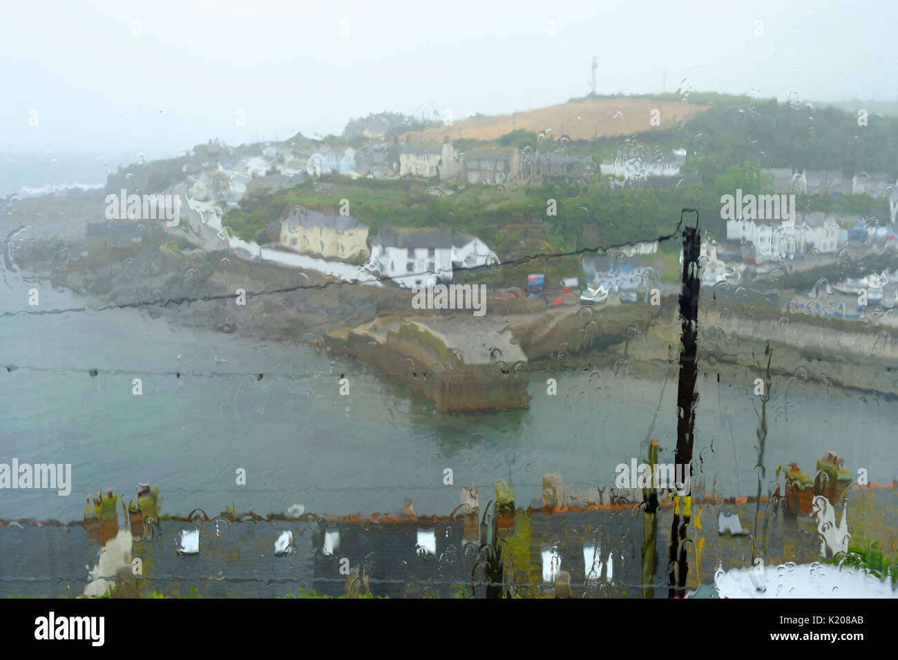 Rainy day in vacations, view from window, Porthleven, Cornwall, England, United Kingdom - Stock Image
