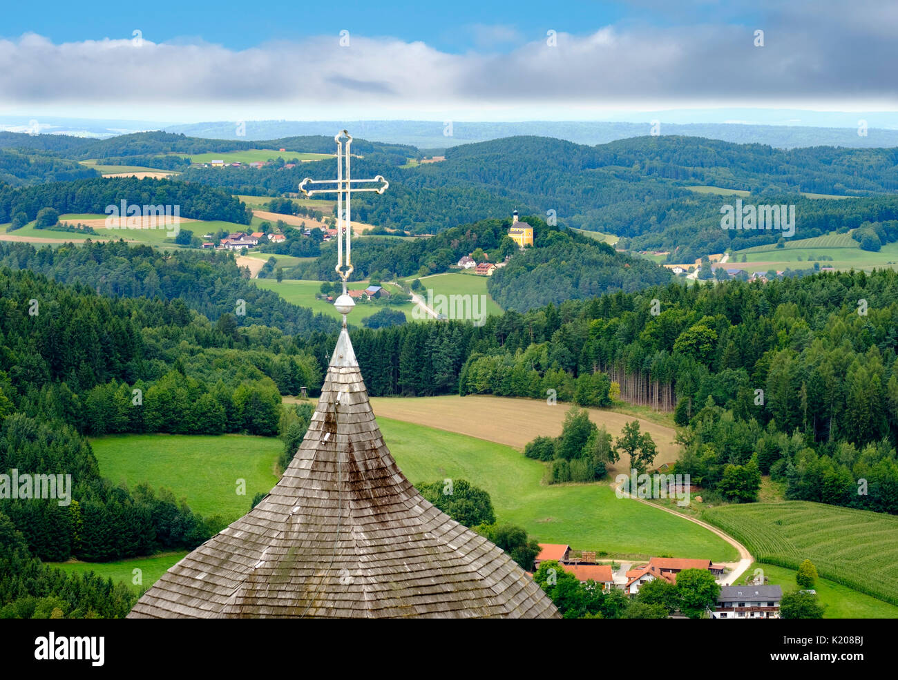 Church spire of the castle chapel and church in Marienstein, view from castle Falkenstein, Bavarian Forest, Upper Palatinate - Stock Image