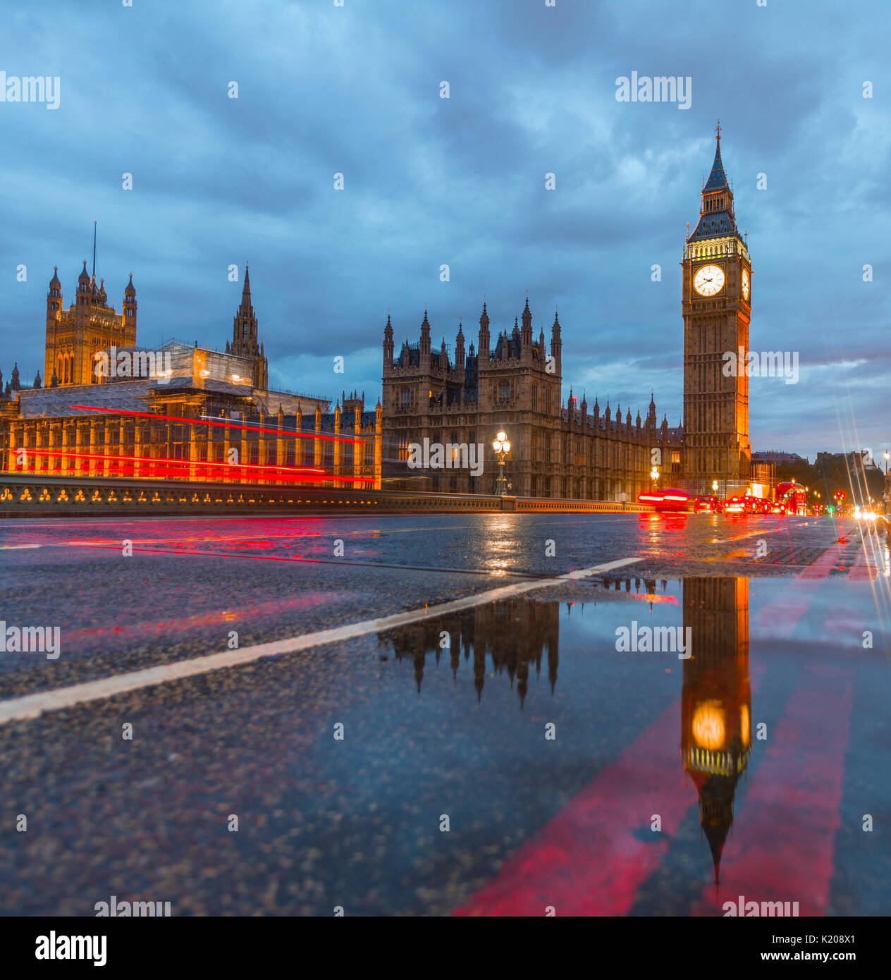 Westminster Bridge, Palace of Westminster, Houses of Parliament with reflection, Big Ben, Light trails, City of Westminster - Stock Image