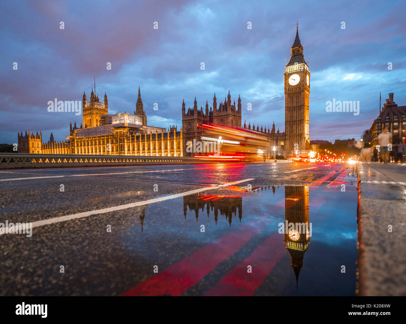 Light traces, double-deck bus, Westminster Bridge, Palace of Westminster, Houses of Parliament with reflection, Big Ben - Stock Image