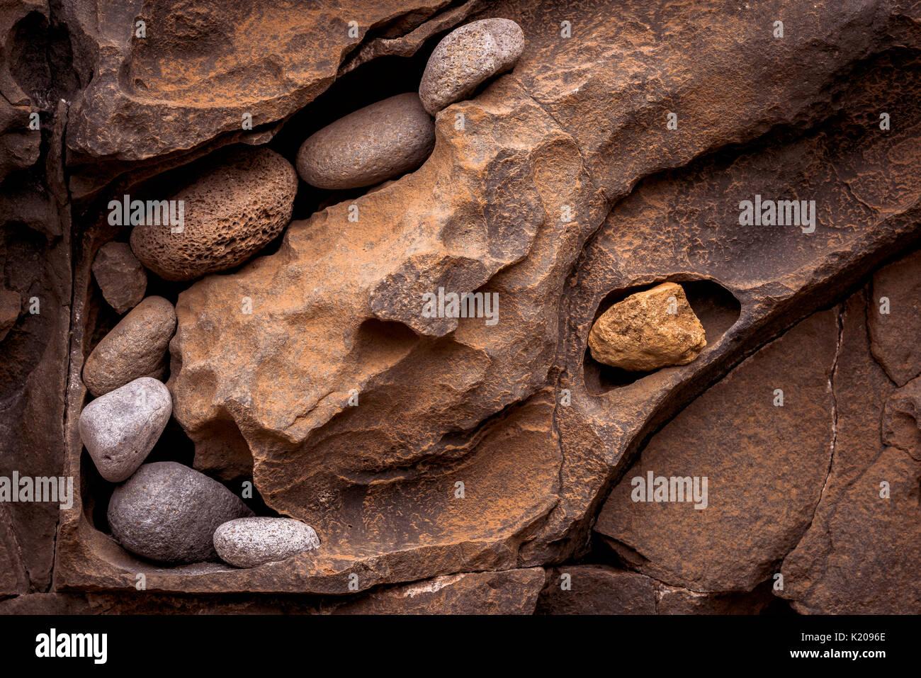 Stone deposit on rock wall, Ribera de Janela, Madeira, Portugal - Stock Image