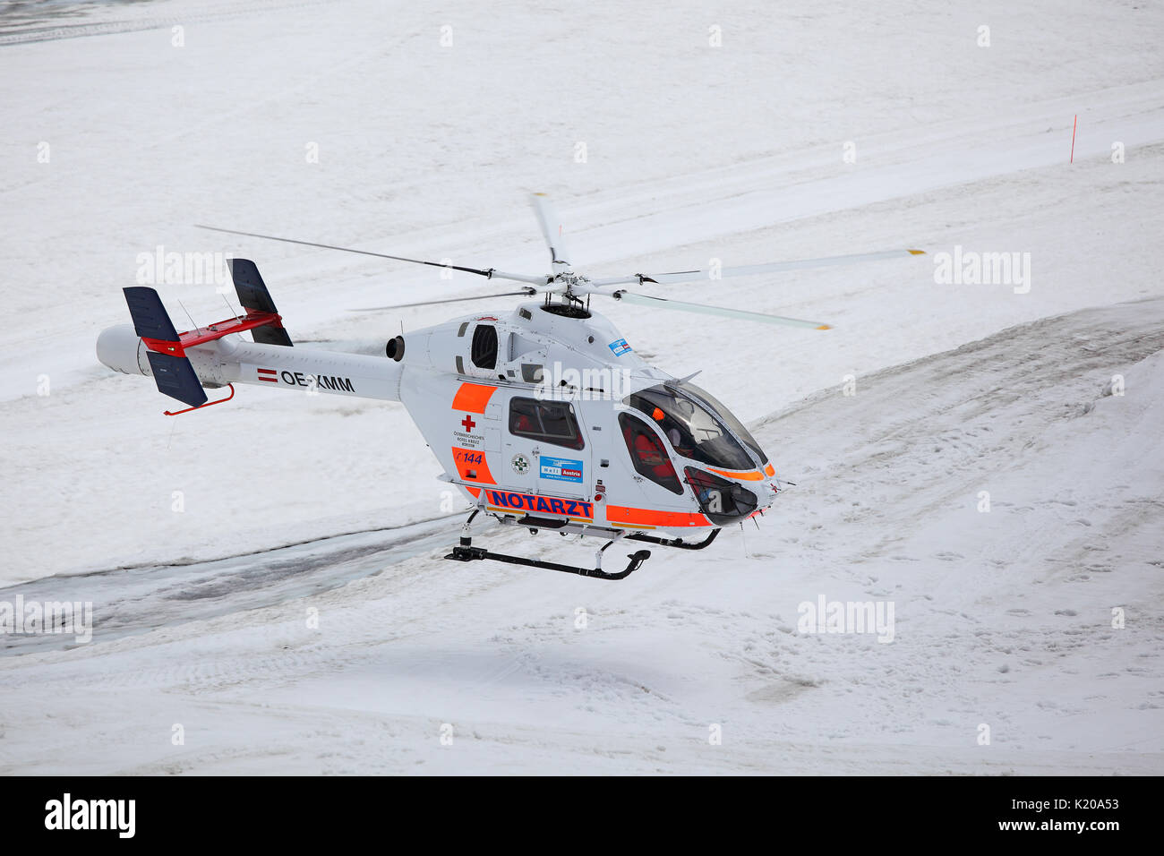 Rescue helicopter of the Austrian Red Cross in operation on the Dachstein glacier, mountain station on the Dachstein - Stock Image