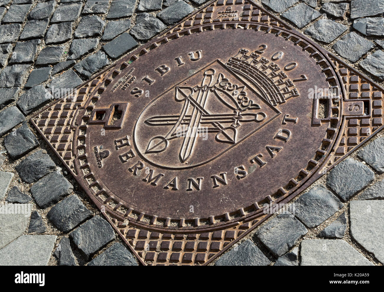 Manhole cover, Sibiu, Hermannstadt, Romania Stock Photo
