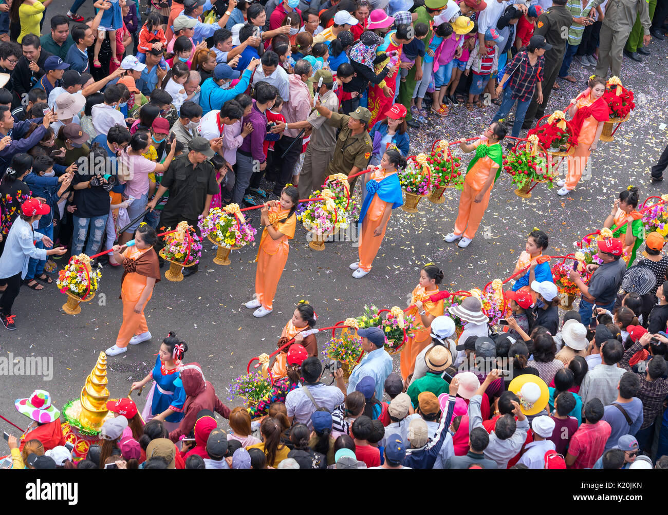 Festival Chinese Lantern with car flags, girls on the car donated money, fortune for visitors as good luck early in the street parade in Binh Duong - Stock Image