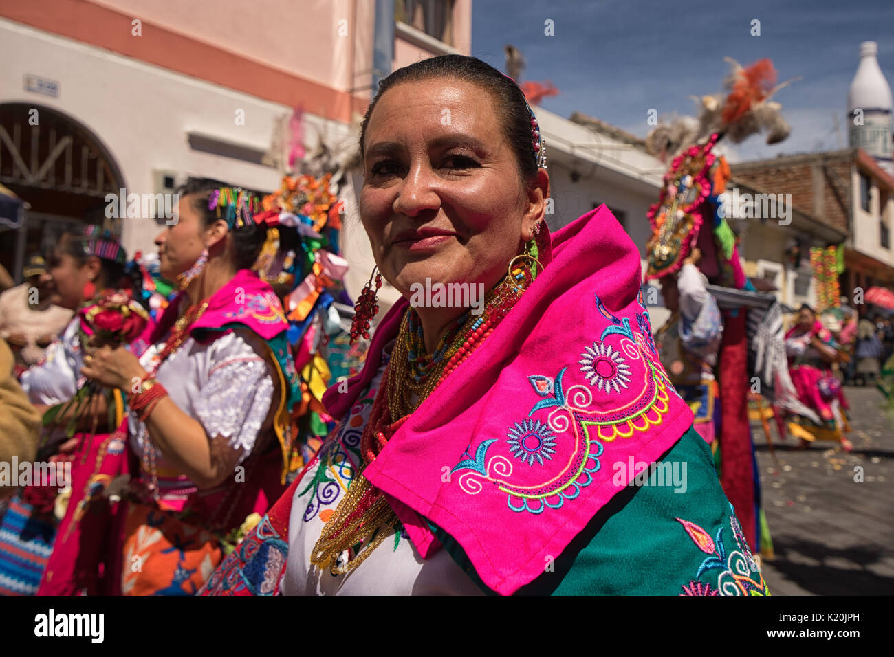 June 17, 2017 Pujili, Ecuador: indigenous kichwa woman in colorful traditional clothing at the Corpus Christi parade - Stock Image