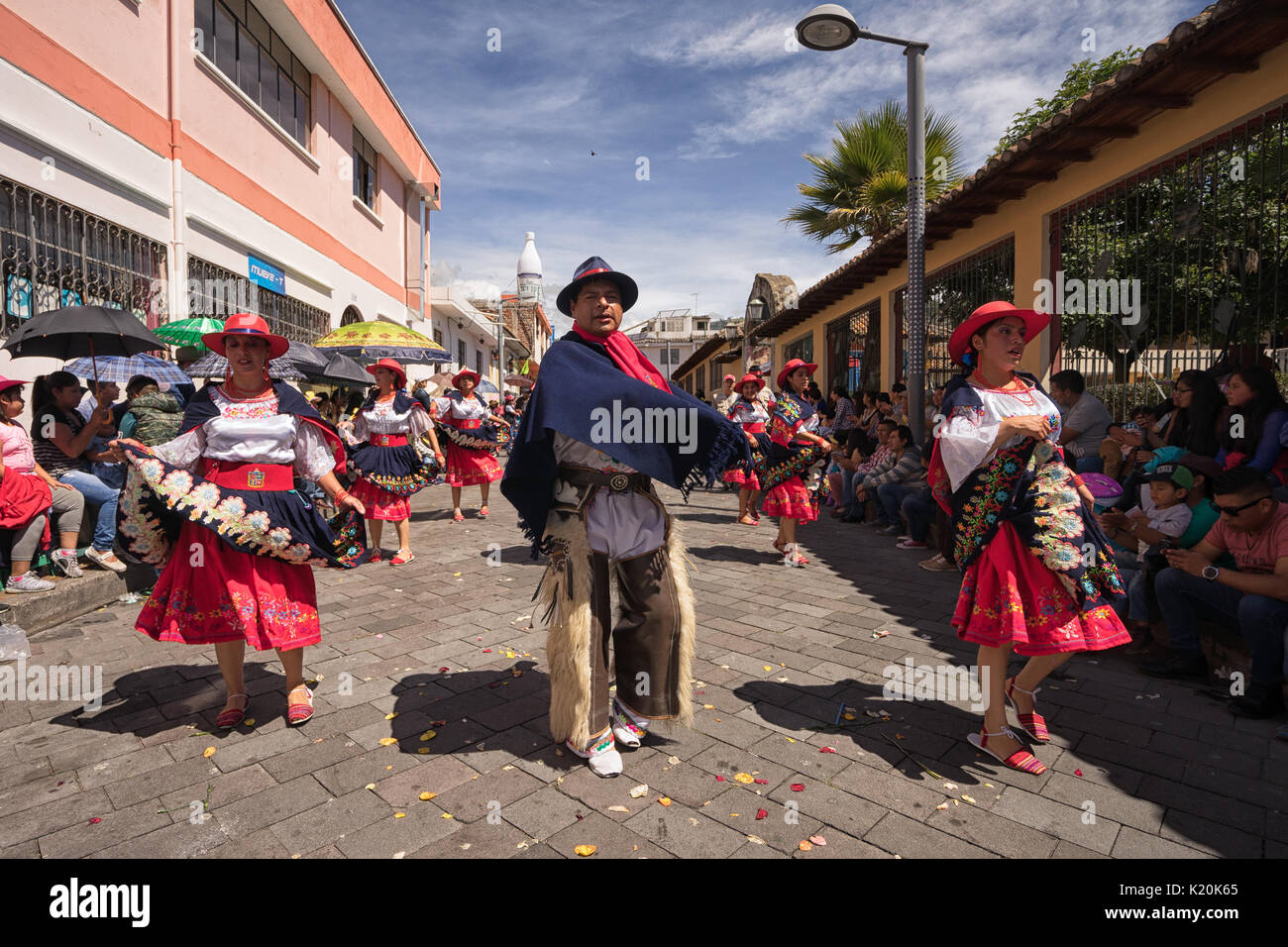 June 17, 2017 Pujili, Ecuador: indigenous kichwa people in traditional clothes dancing at the Corpus Christi parade - Stock Image