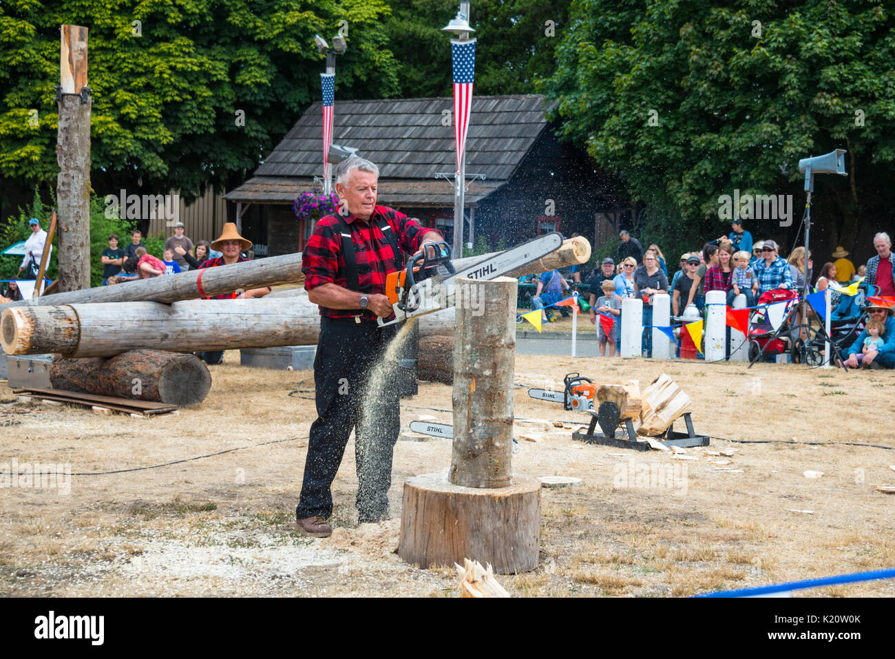 Lumberjack Skill Demonstration Chainsaw Art Evergreen State Fair Monroe Washington - Stock Image
