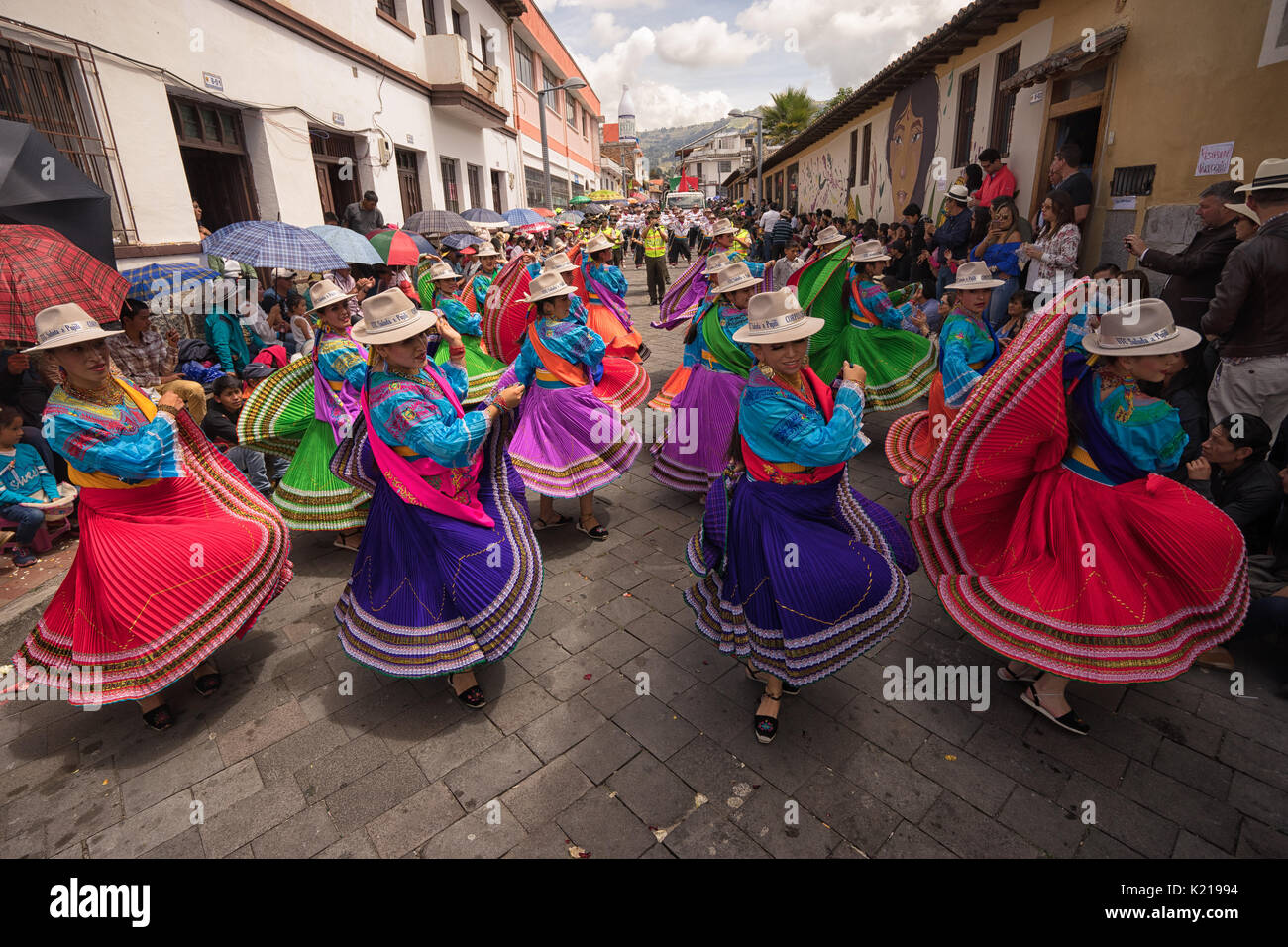 June 17, 2017 Pujili, Ecuador: indigenous women in brigthly colored clothng performing on the street during Corpus Stock Photo