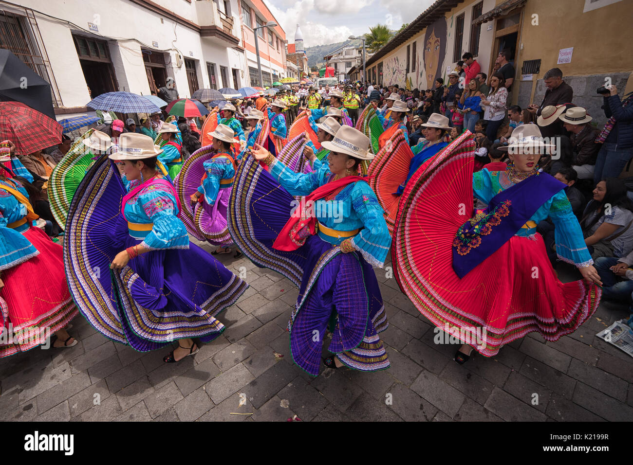 June 17, 2017 Pujili, Ecuador: indigenous women in brigthly colored clothng performing on the street during Corpus Christi parade - Stock Image