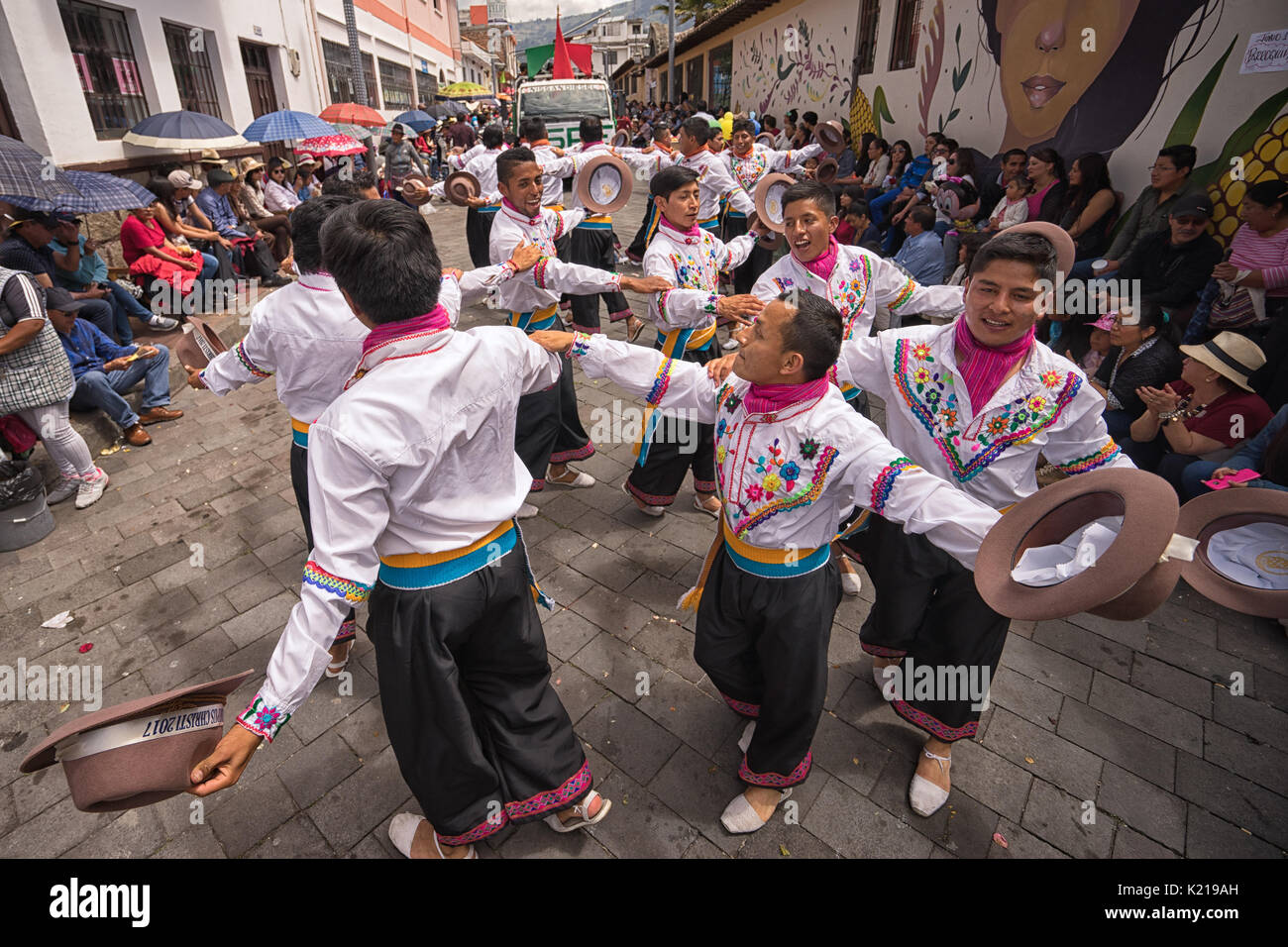 June 17, 2017 Pujili, Ecuador: male dancers in traditional clothing performing on the street during Corpus Christi parade - Stock Image