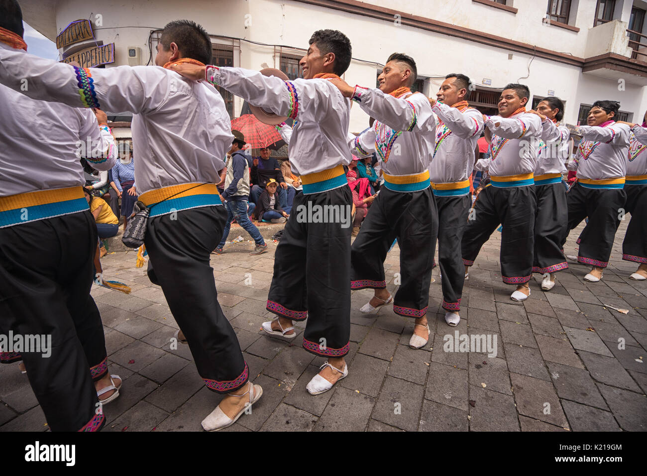 June 17, 2017 Pujili, Ecuador: male dancers in traditional clothing performing on the street during Corpus Christi Stock Photo