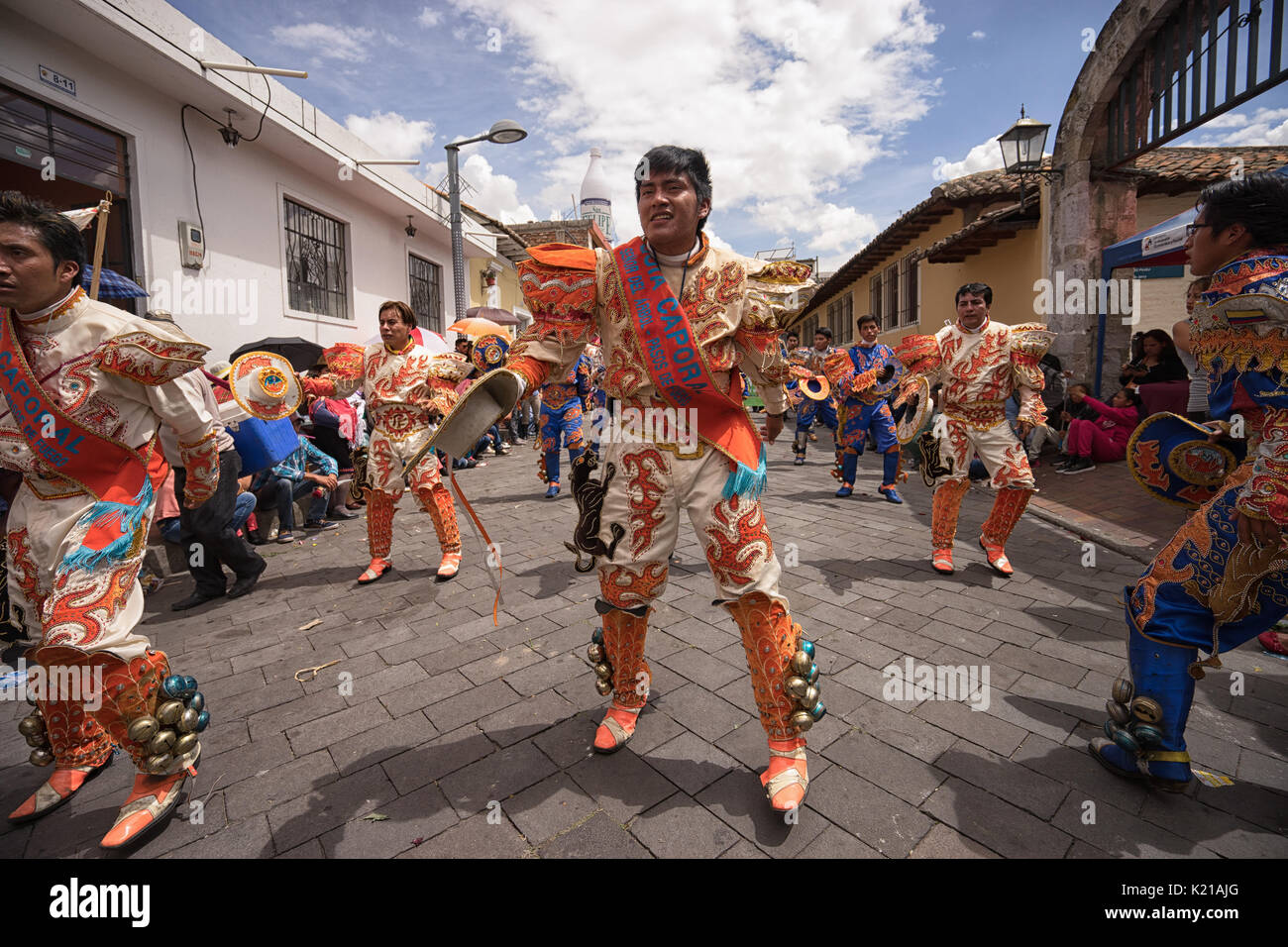 June 17, 2017 Pujili, Ecuador: male dancers in brightly colored costumes  performing on the street during Corpus Christi parade - Stock Image