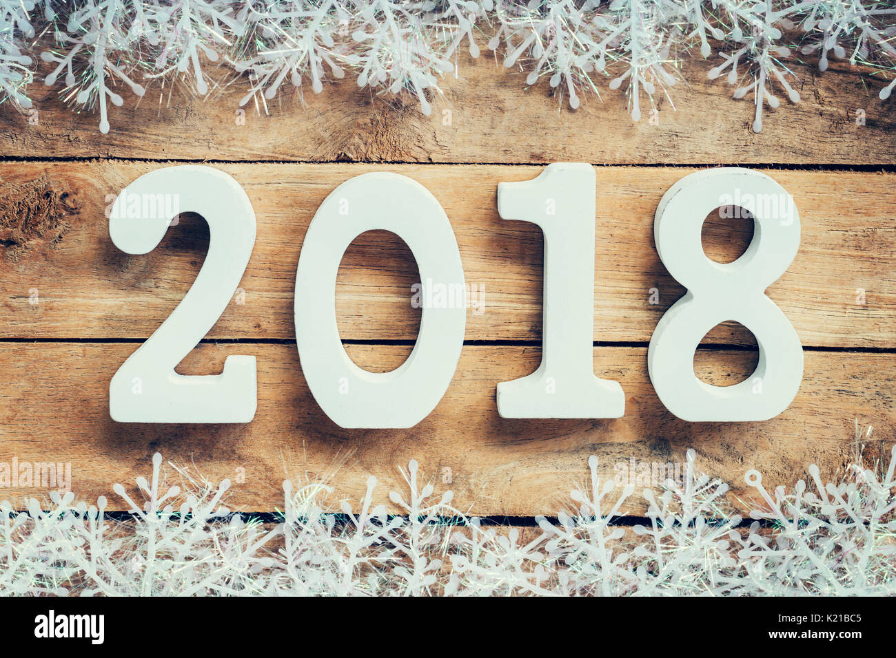 Wooden brown New Year 2018, christmas background and snowflakes with space. - Stock Image