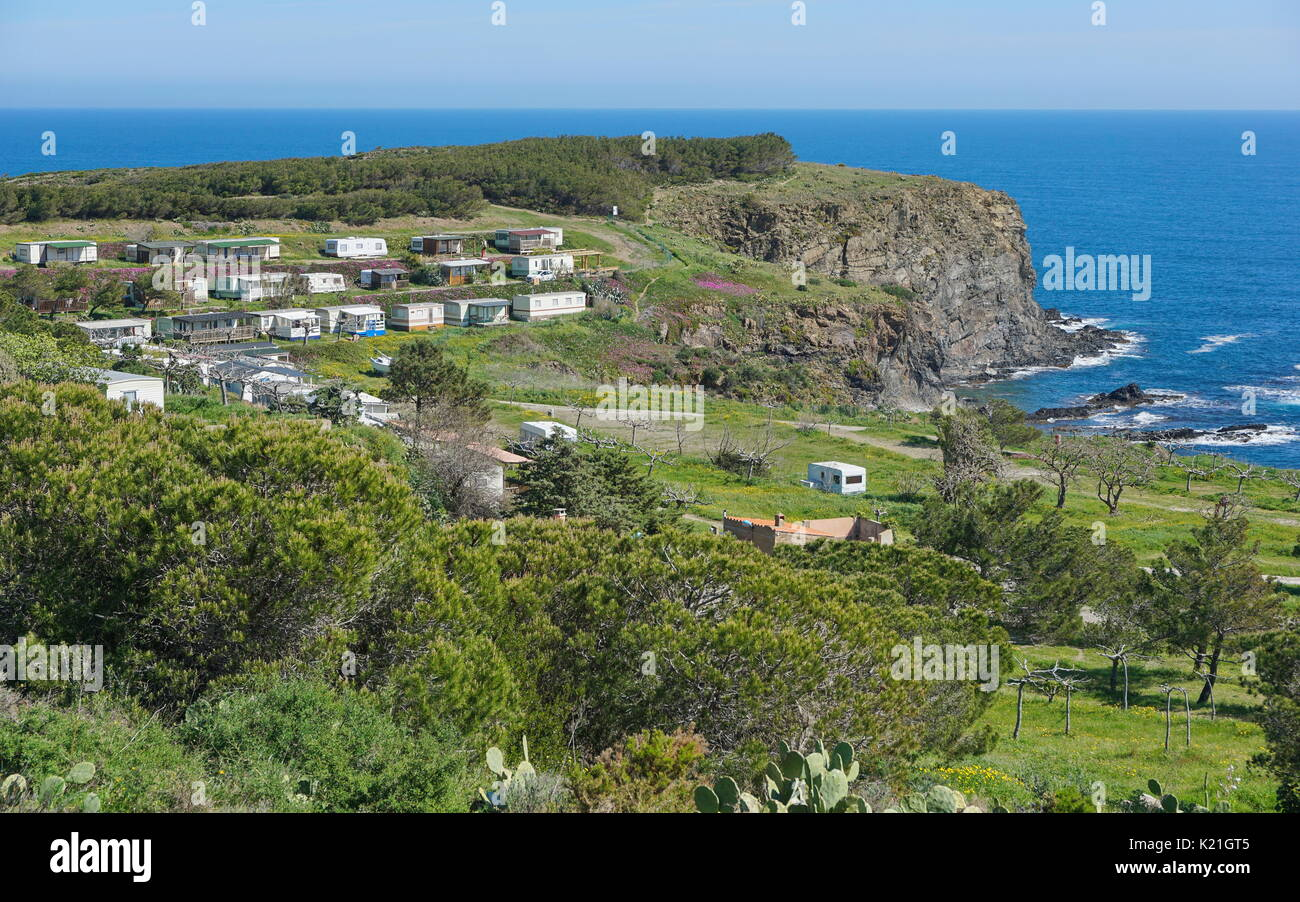 Coastal landscape a campsite with mobile homes and caravans on a rocky shore of Mediterranean sea, Pyrenees Orientales, south of France, Roussillon - Stock Image