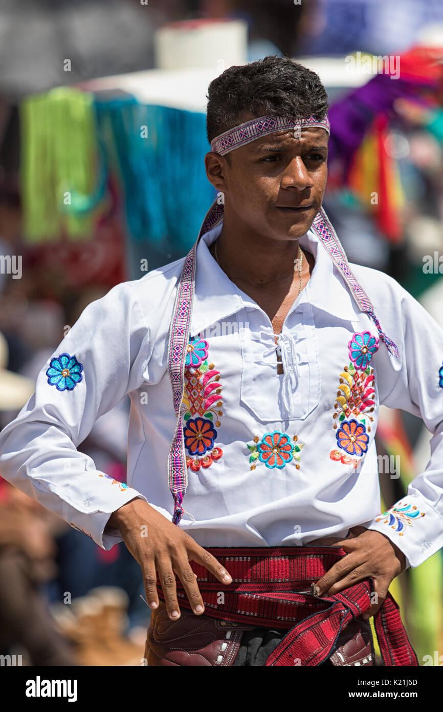 June 17, 2017 Pujili, Ecuador: indigenous kichwa man in traditional clothing at the Inti Raymi parade - Stock Image