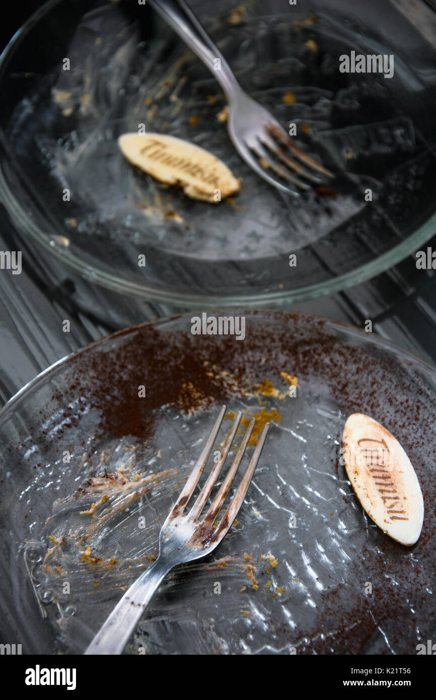 Empty dirty plate of Italian tiramisu cake - Stock Image