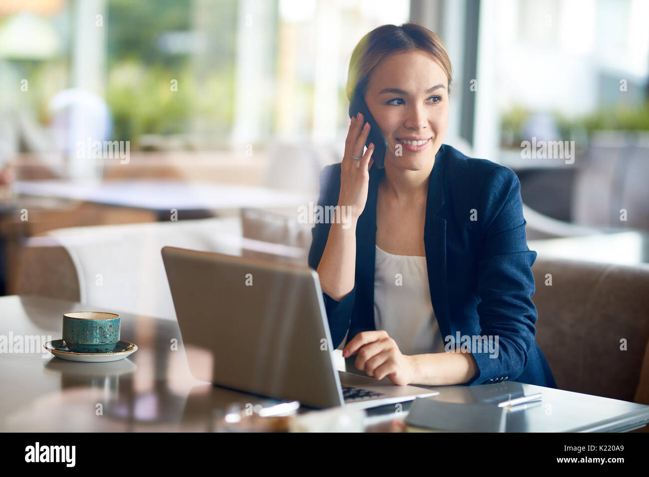 Pretty Entrepreneur Working at Cafe - Stock Image