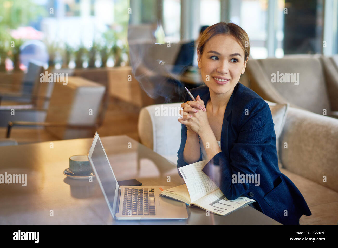 Asian Entrepreneur Working at Cafe - Stock Image