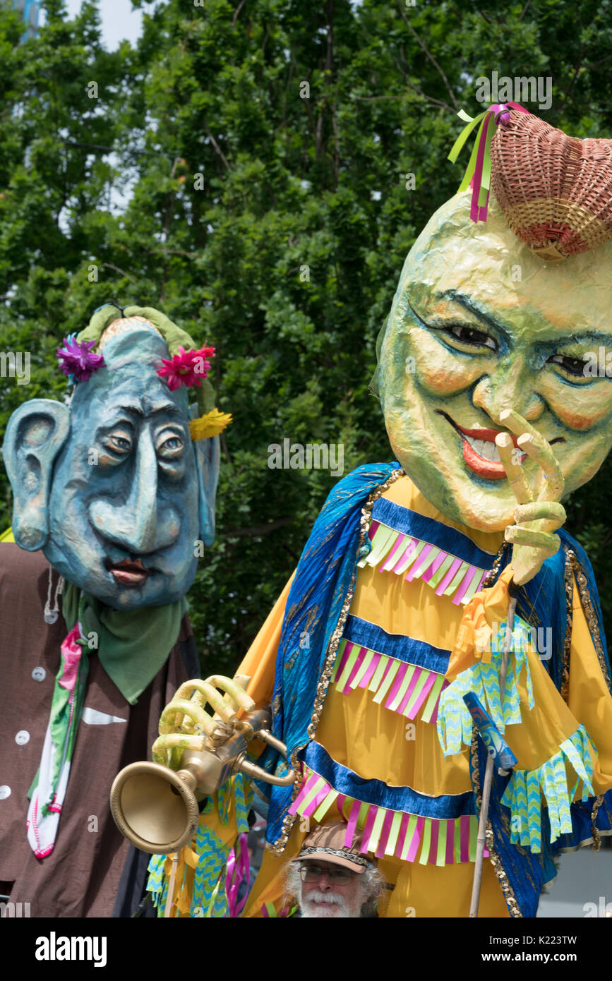 Two effigys of chacters in papier-mache at the Fremont Soltice Parade, Seattle, Washington, United States - Stock Image