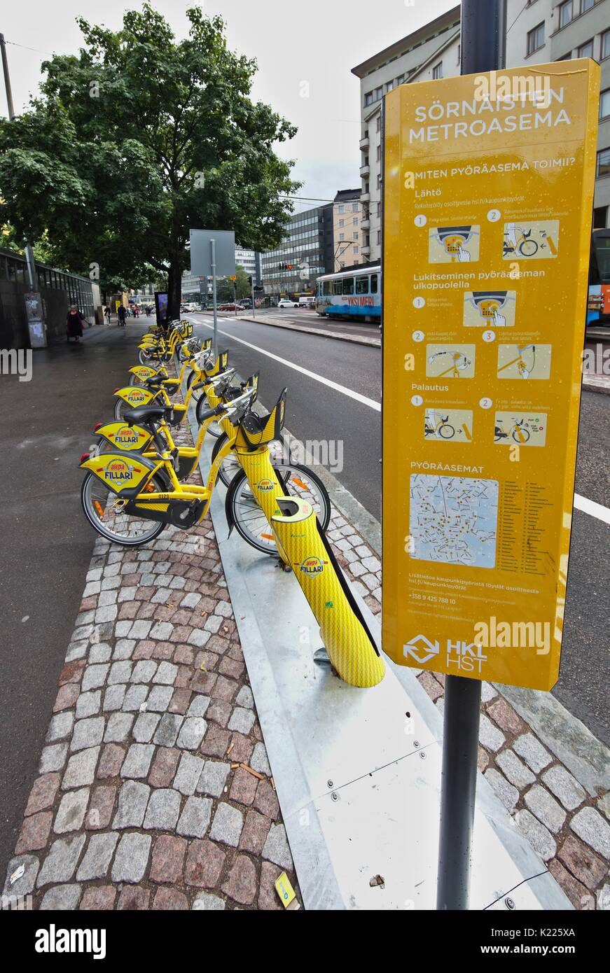 Rental bikes in city, parked, yellow - Stock Image