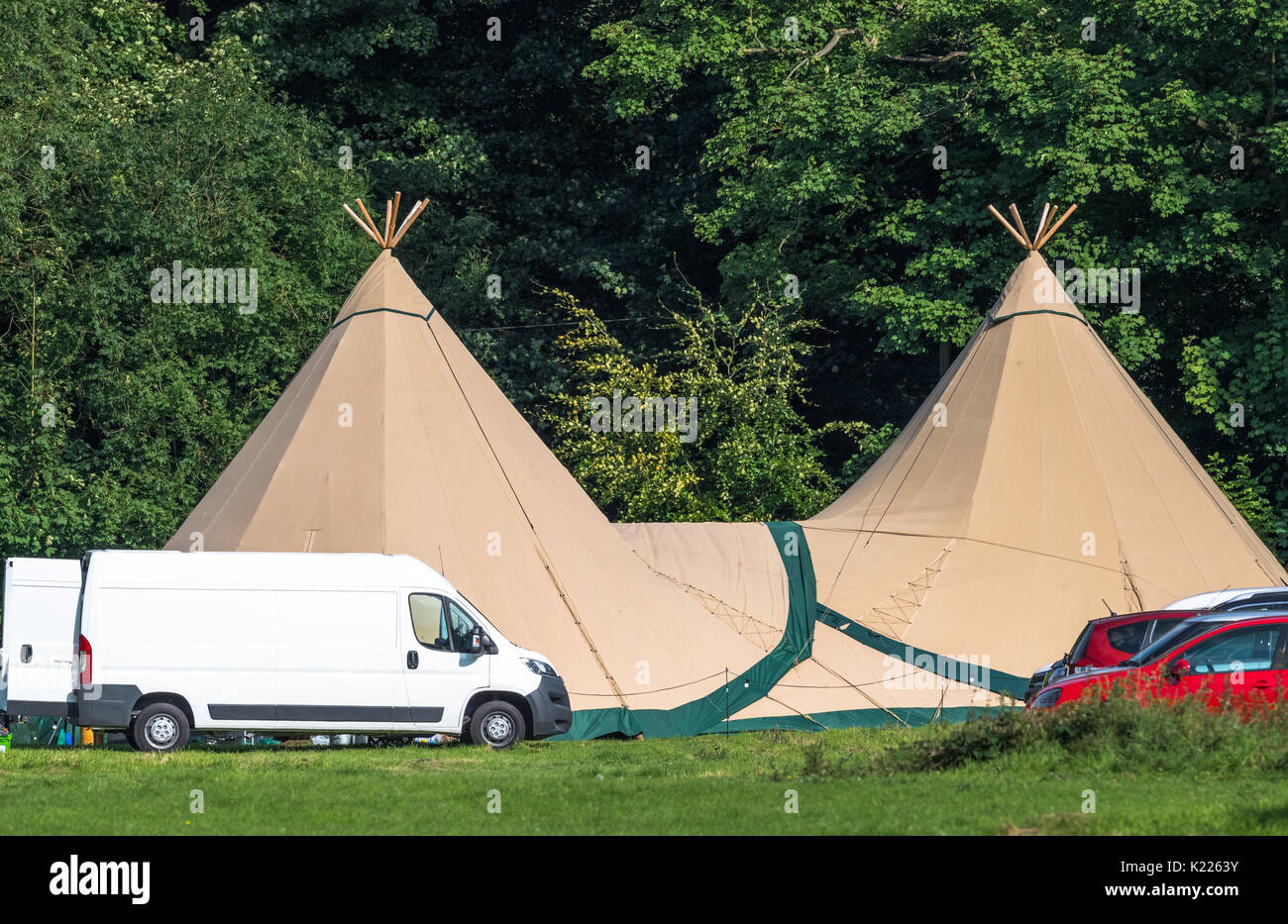 Two large tepees in a field ready for an event. - Stock Image