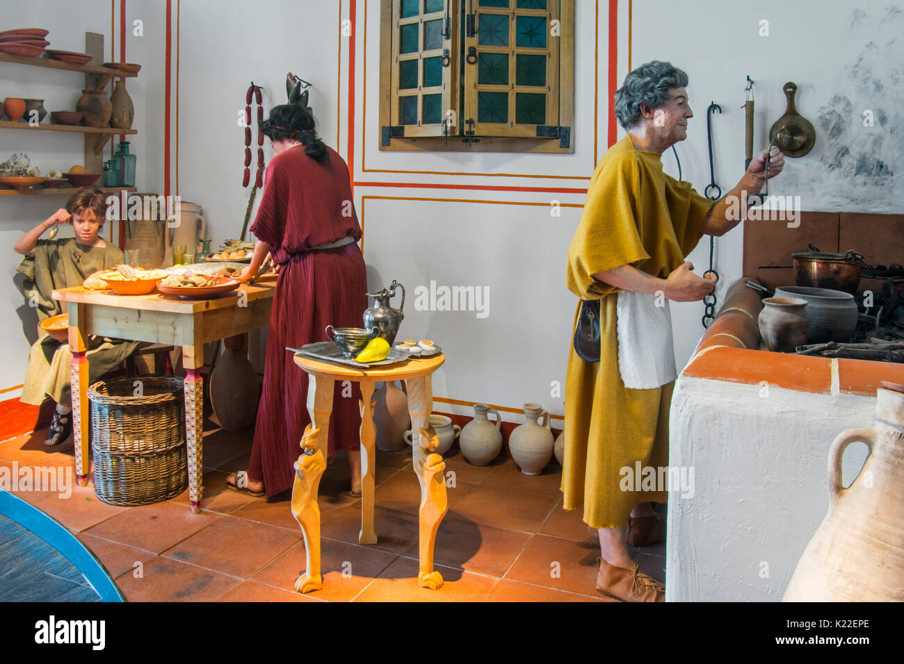 Diorama showing life-size figures depicting daily life in the kitchen of a Roman villa, Echternach, Luxembourg - Stock Image